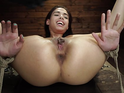 Young girl sits obedient in the face of a rough BDSM cam play