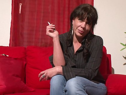 Still smoking and still hot full-grown brunette is ready for some masturbation