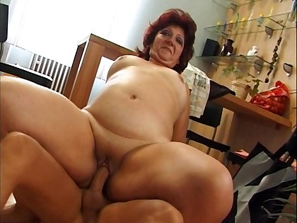 Grown-up slut Corrie with red hair enjoys getting fucked on the floor