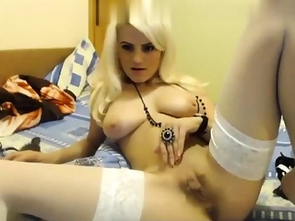 Solo blonde in low-spirited louring stockings masturbates