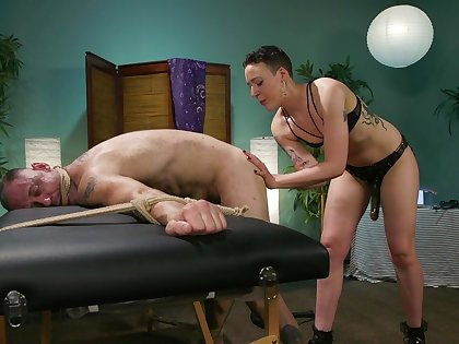 Dominant slut Lilith Luxe uses a strapon to be hung up on her hubby's ass