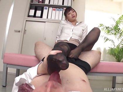 Naughty Japanese chick Mitani Akari teases and gives a footjob